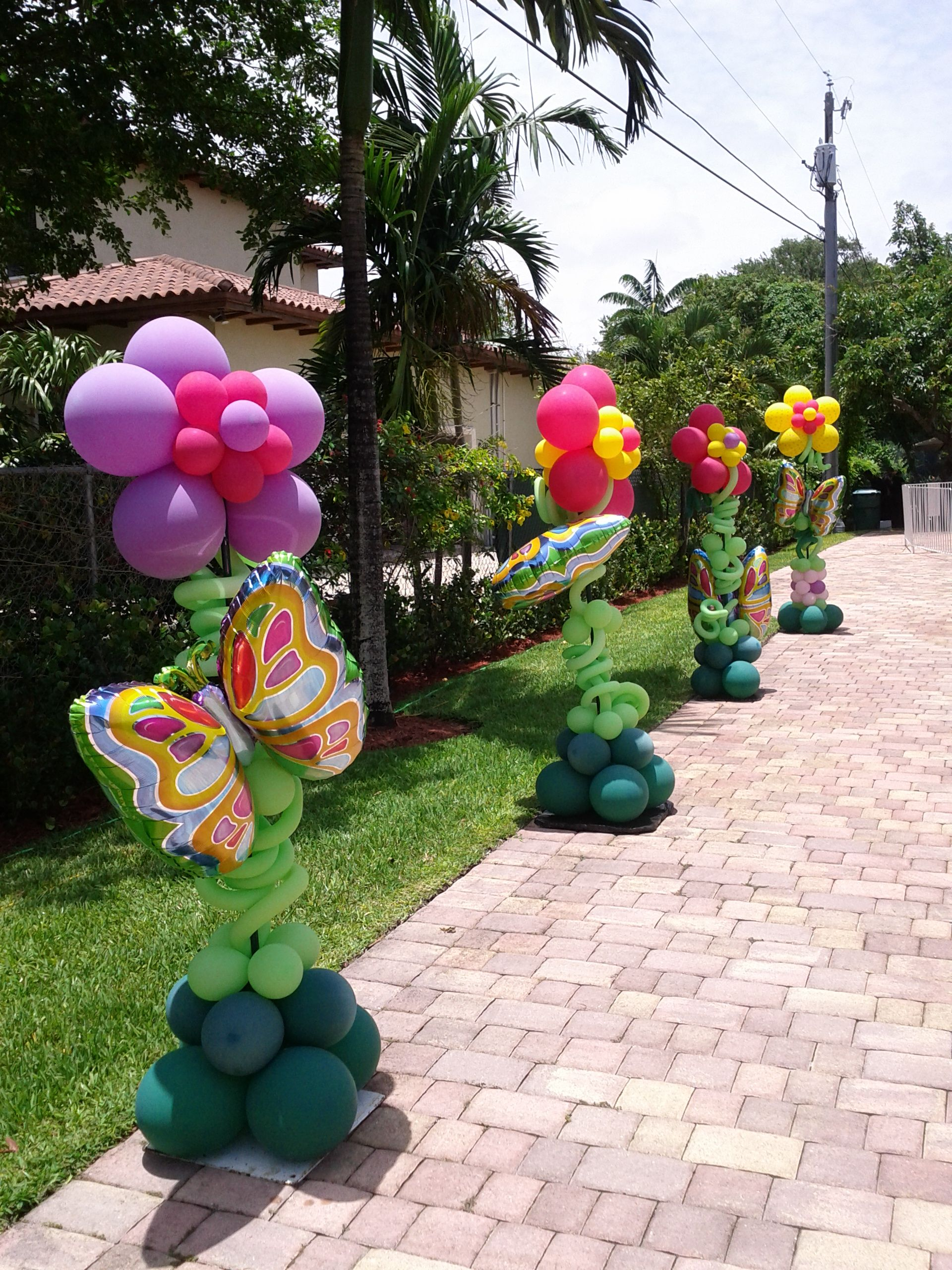 backyard party decoration with balloon flowers sculpture and