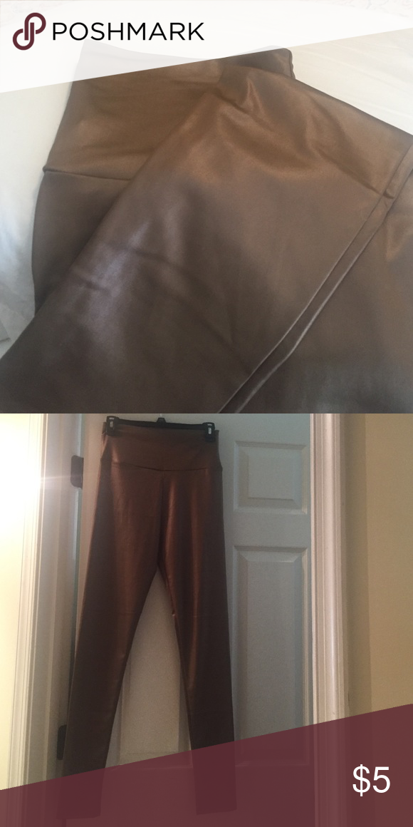Leather look skinny leggings Beautiful deep khaki color, perfect to wear with fall colors...🍂🍁🍂....never worn Pants Leggings
