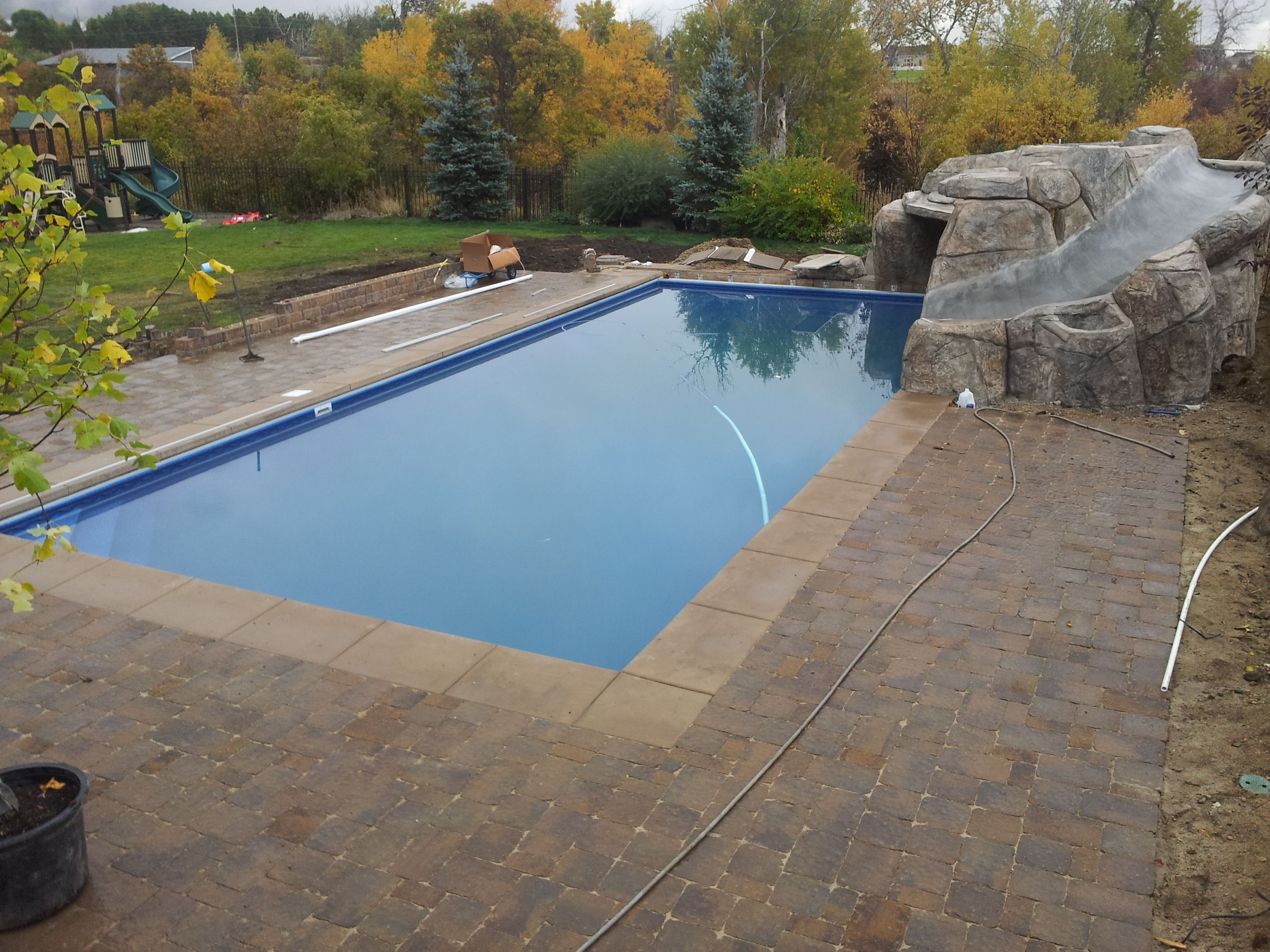 Backyard Swimming Pool Diving And Jumping Faux Rock And Cave Diving Board Paver Sitting Walls