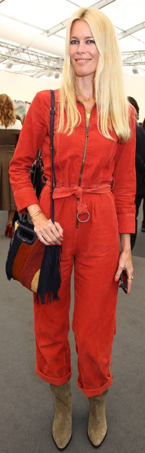 Who Made Claudia Schiffer S Red Jumpsuit Fringe Handbag And Tan Suede Ankle Boots Red Jeans Wearing Red Casual Winter Outfits