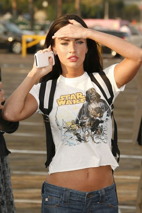the woman is wearing a star wars shirt and still looks gorgeous. unbelievable.