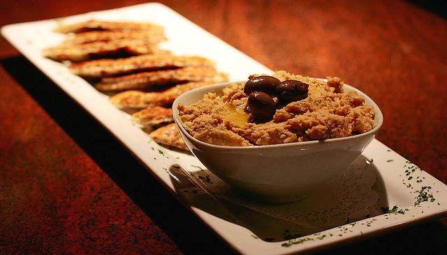 Photo of traditional hummus, black bean hummus and black eyed pea hummus
