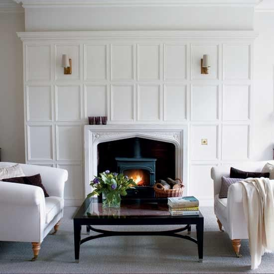Beef Up The Mantel With Paneling White Paneling Fireplace Design Fireplace Surrounds
