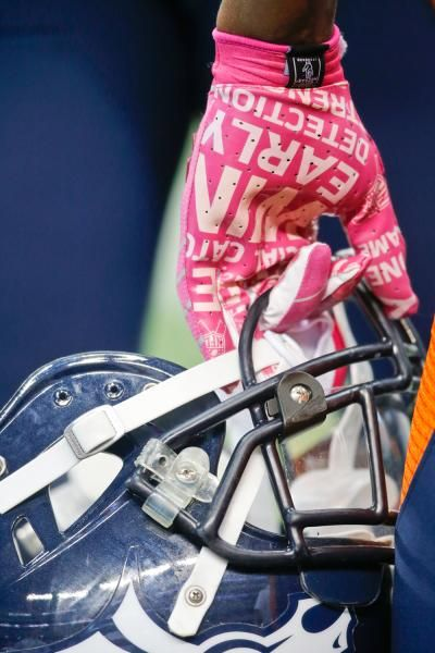 NFL players showed their support for breast cancer awareness by wearing pink gloves and other equipment. (Sharon Ellman/AP)