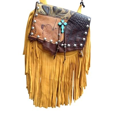 "TURQUOISE SUPREME MARTY - so super soft, made of gold deerskin with a 7"" gold deerskin fringe. The flap features several different types of printed leather. The centerpiece is a bold turquoise cross with suede laces with silver beads flowing down. Etched silver metal studs adorn the flap. Wear bag clipped to belt loops for hands-free carrying of your essentials. Interior includes a leather strap. Add the strap when you want a completely different look."