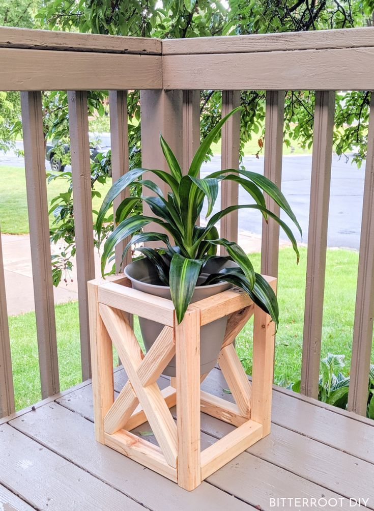 DIY Plant Stand is part of Outdoor wood projects, Scrap wood projects, Diy plant stand, Rustic plant stand, Wood projects, Wood plant stand - Build a DIY plant stand to showcase your favorite foliage and add the perfect modern farmhouse touch to your porch or patio decor