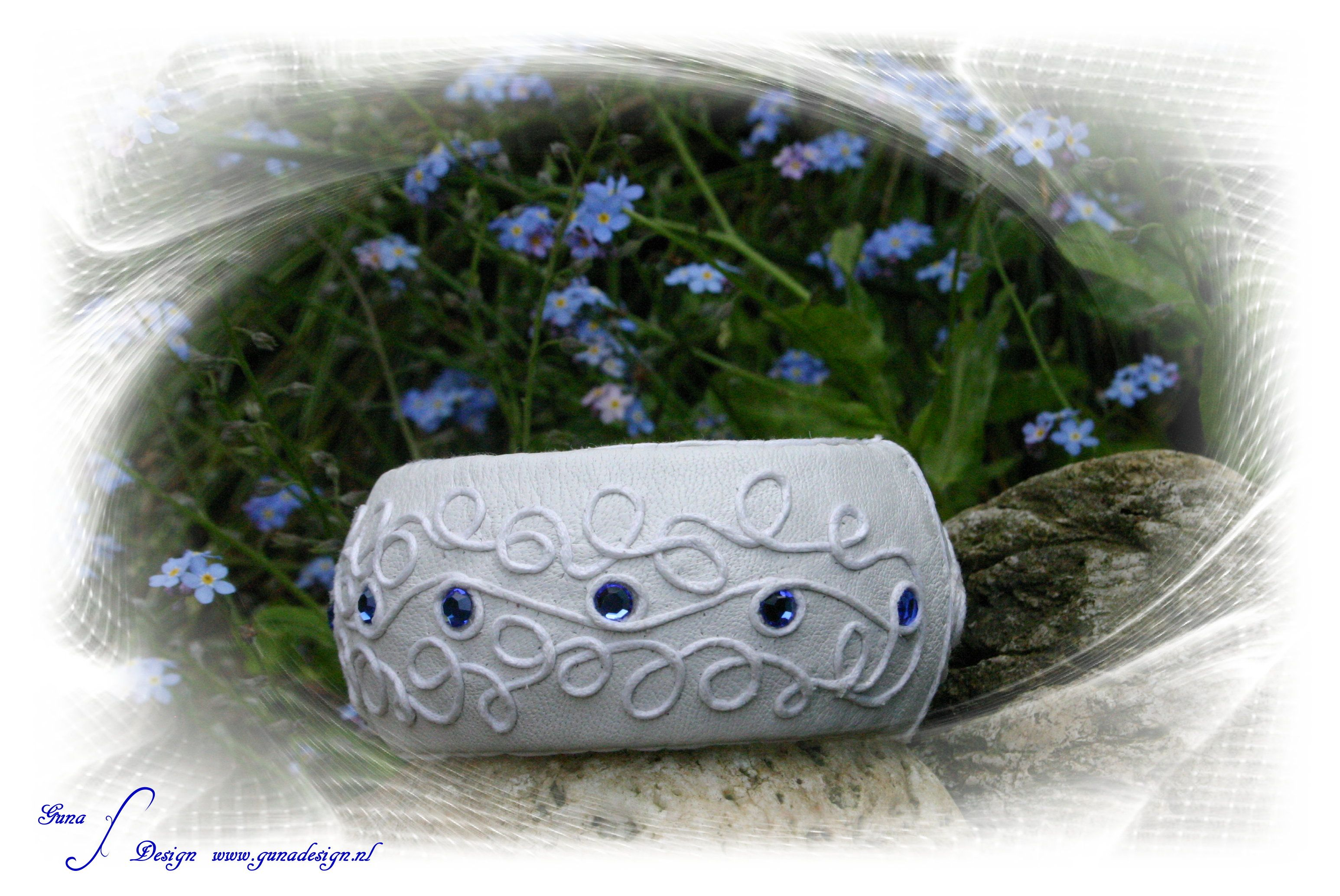 Something blue  Bracelet cuff made from Preciosa crystals and leather.