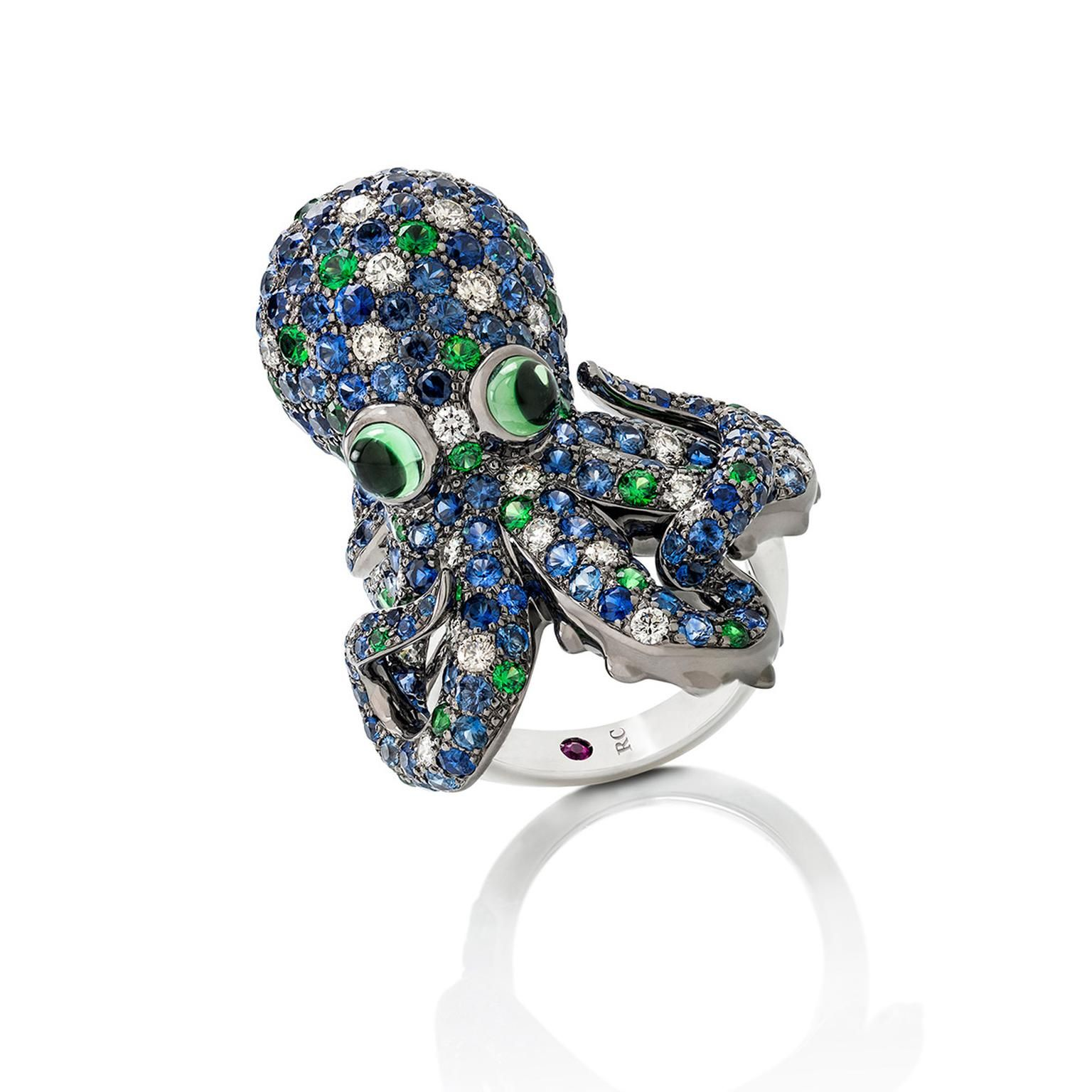 Roberto Coin Octopus ring, with blue sapphires, garnets, tourmalines and white diamonds creating the character on your finger. Blue and green. Very under the sea. The best fashion forward design jewellery moments from Baselworld 2017 on day 3: http://www.thejewelleryeditor.com/jewellery/top-5/baselworld-jewellery-day-three-highlights/ #jewelry