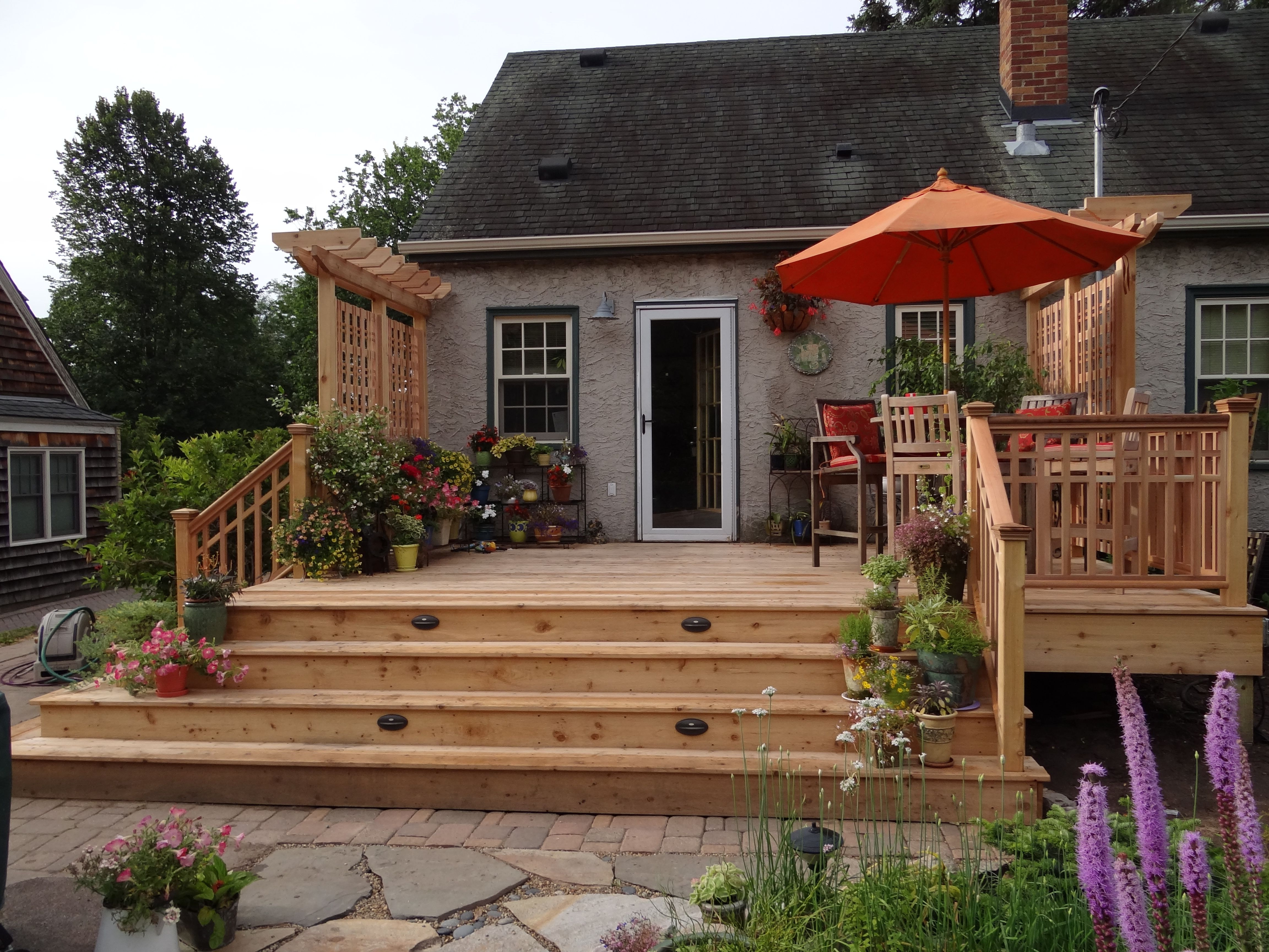 the deck becomes part of the garden backyard patio on steps in discovering the right covered deck ideas id=61269