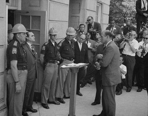 George Wallace stands at the doors of the University of Alabama in an attempt to stop integration.