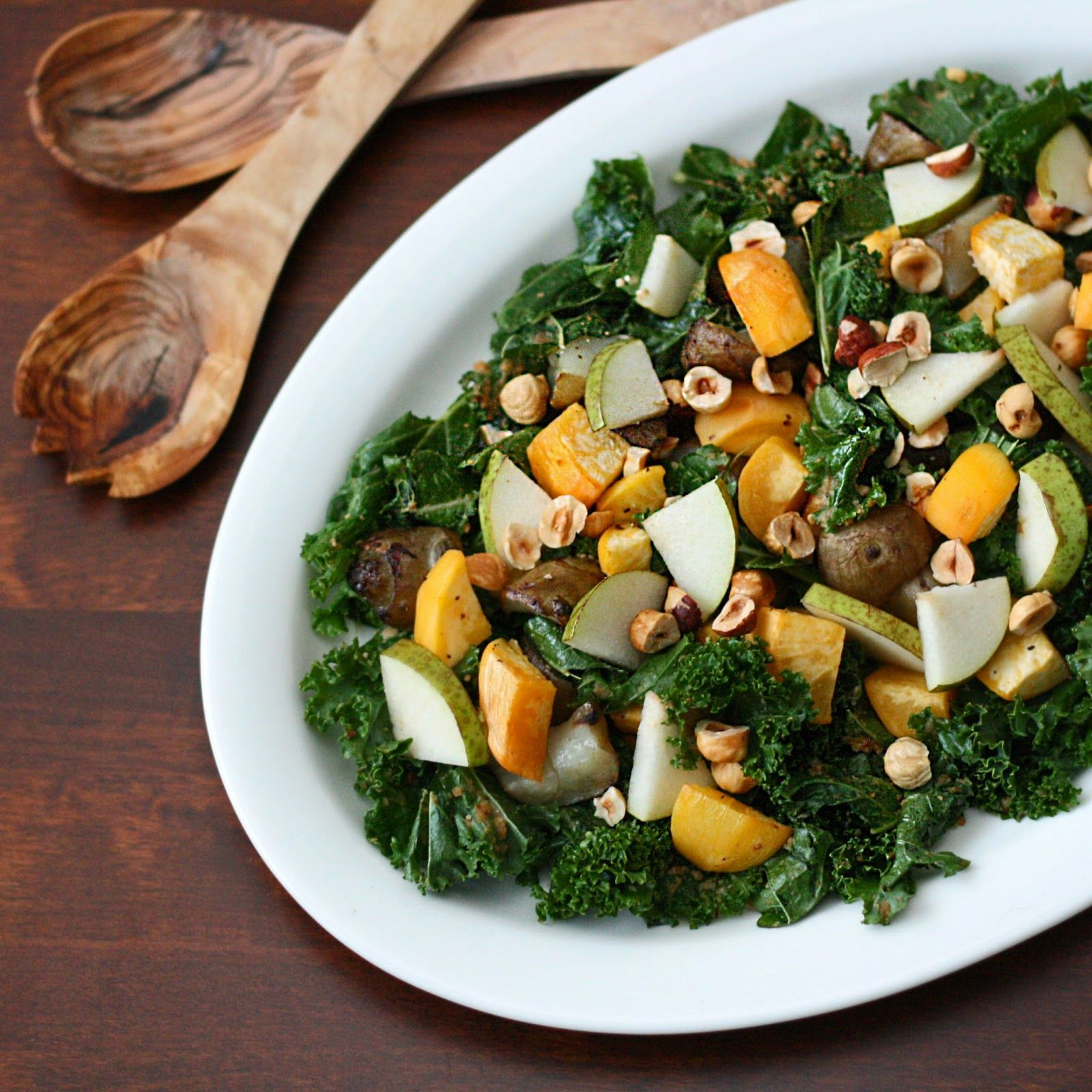 Roasted sunchokes and turnips, kale and juicy pear with creamy, sweet-savory miso-hazelnut dressing. Hearty winter salad. Vegan. - by Maikin mokomin