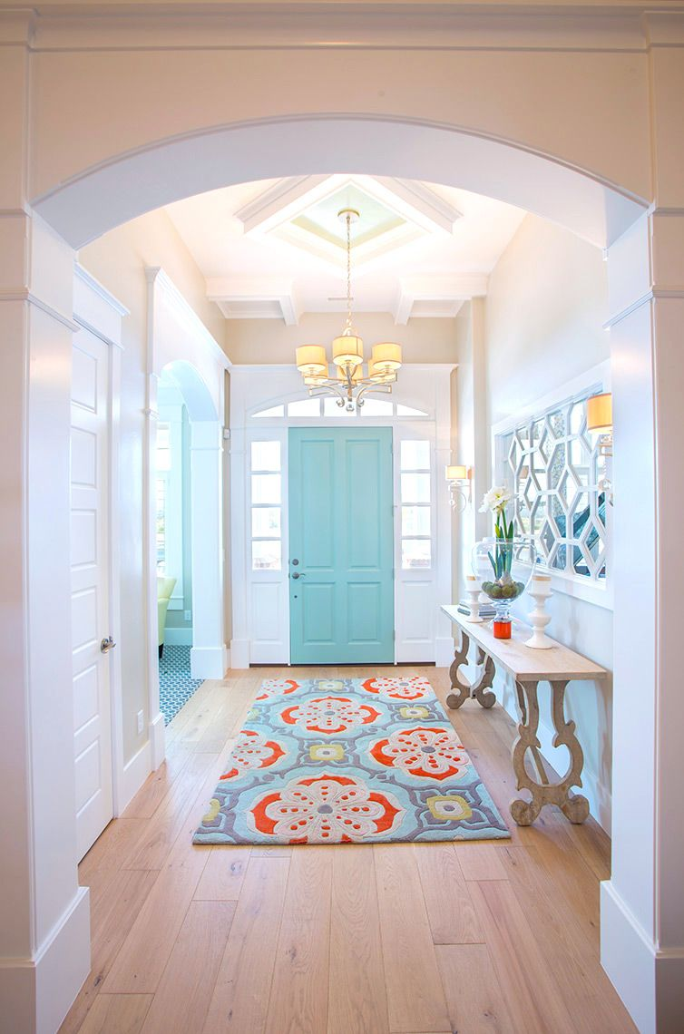 Teal hallway ideas  Foyer entry with colorful runner and an aqua painted front door