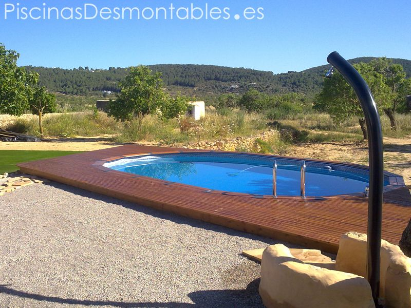 Piscina desmontable gre de madera con ducha solar y for Suelo para piscina desmontable