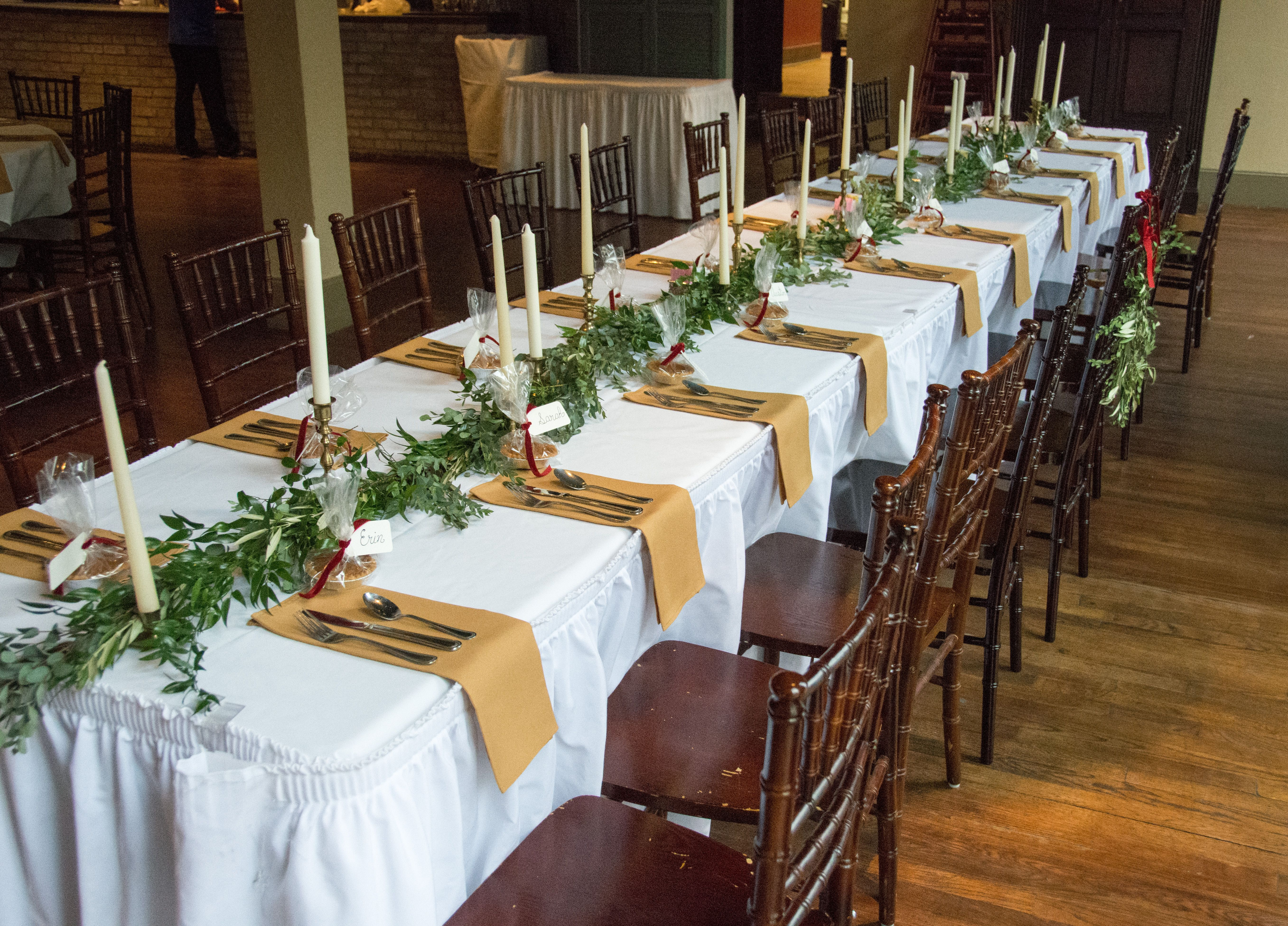 Head Table With Garland Runner Of Ecualyptus And Italian Ruscus Taper Candles In Brass Candle Holders For A Vintage Look