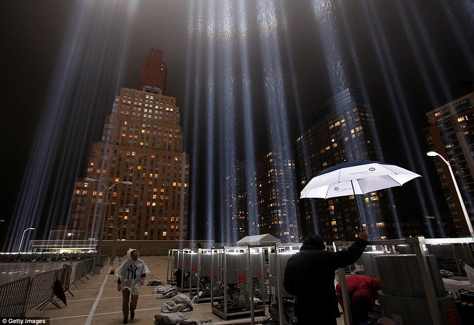 Tribute In Light at Ground Zero A team of 30 electricians stage hands and lighting technicians start shifting the 7000 watt lights into position. & Twinkling tribute to the Twin Towers: World Trade Center rises in ...