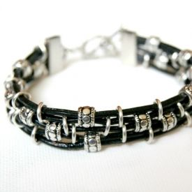 Make up this simple bracelet from leather cord, beads and jump rings.  Full tutorial.