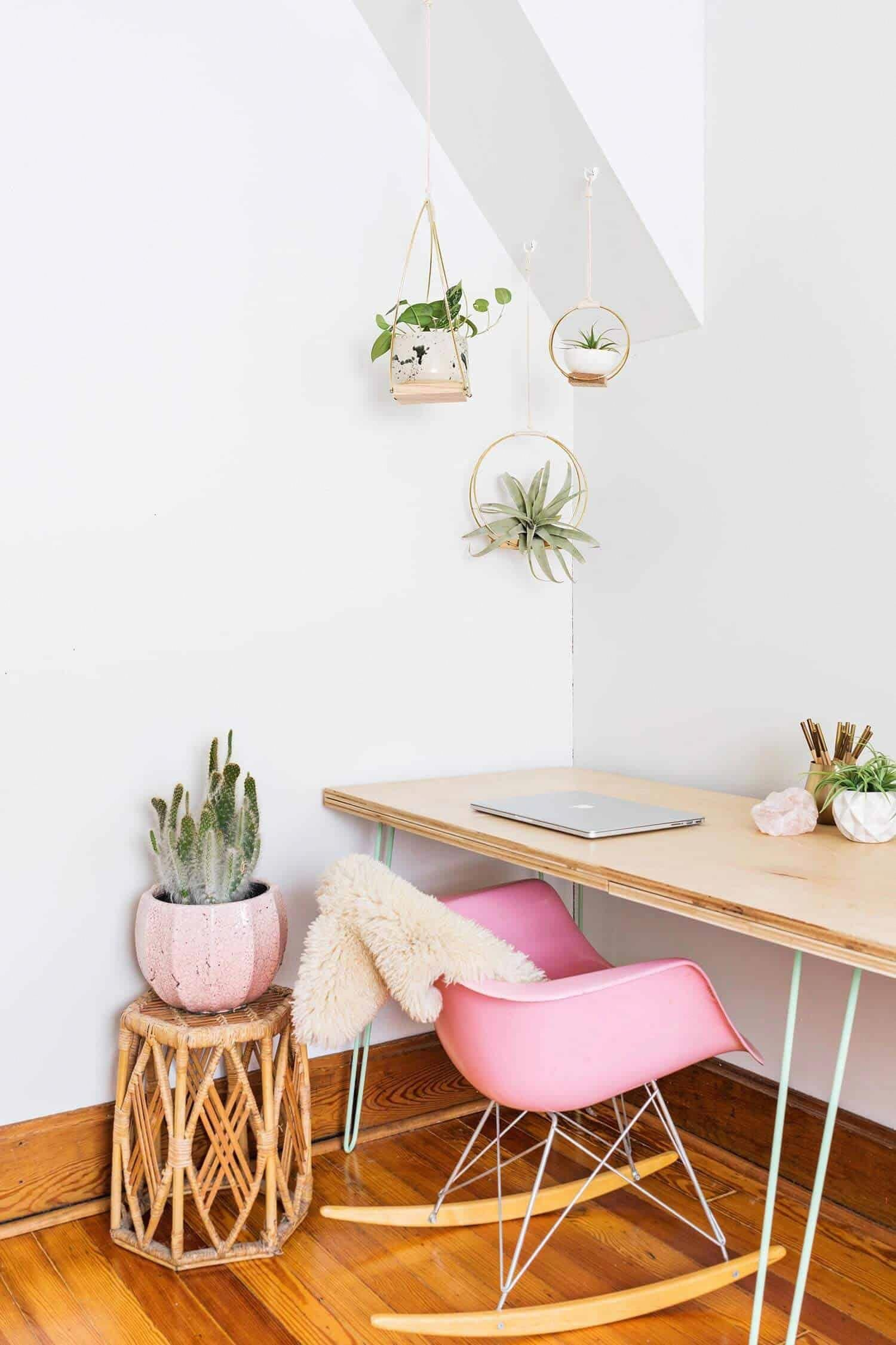 Boho chic meets mid century modern home office with pink rocking chair and hanging planters nonagon style bohodecorideas