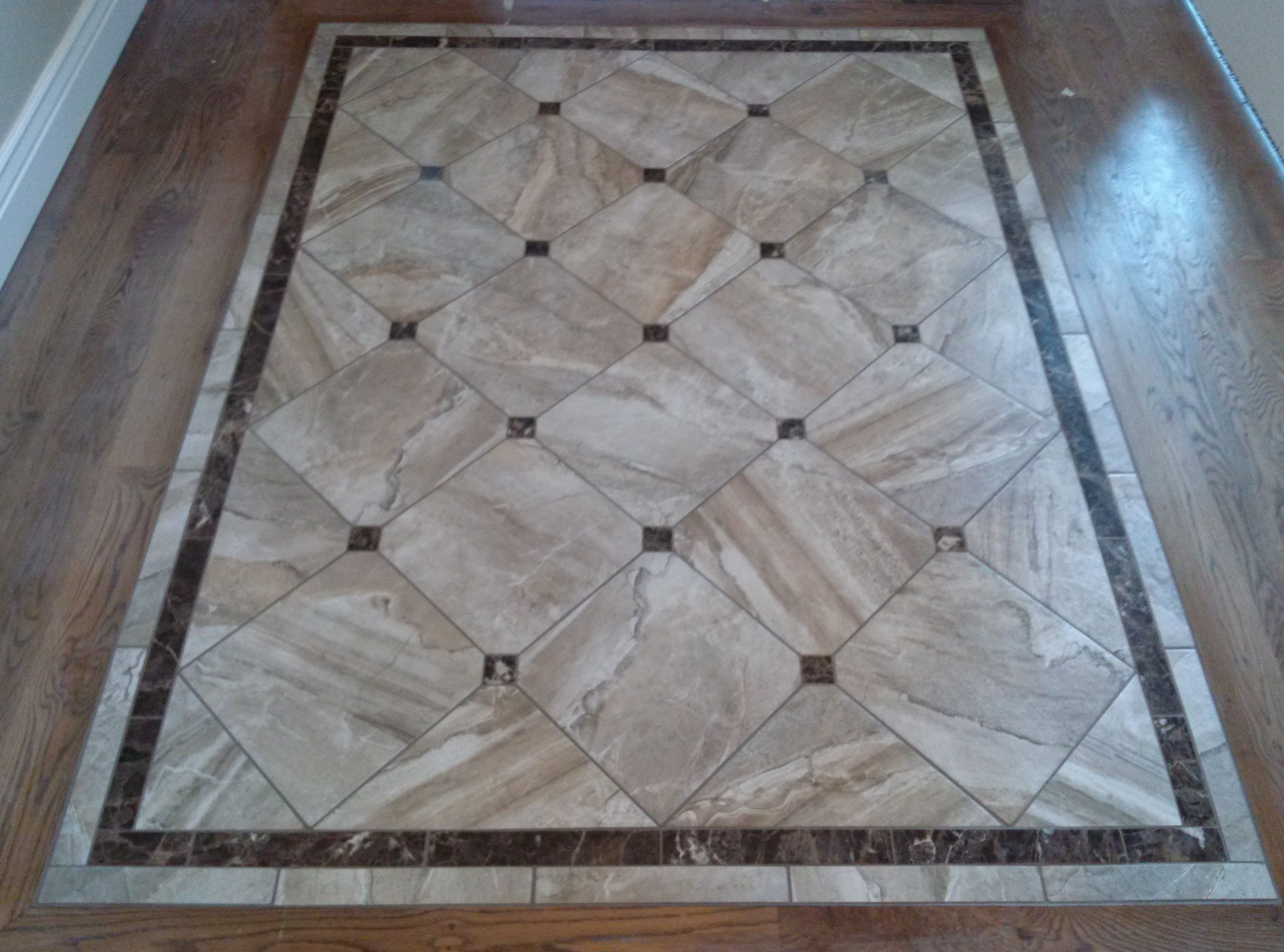 Great looking tile entry way with granite accents for Hardwood floor designs borders