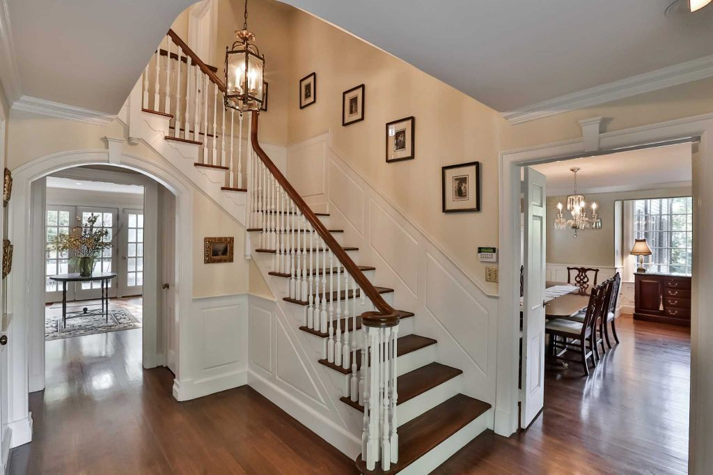 On the market a georgian colonial showcases stately style for Colonial foyer ideas