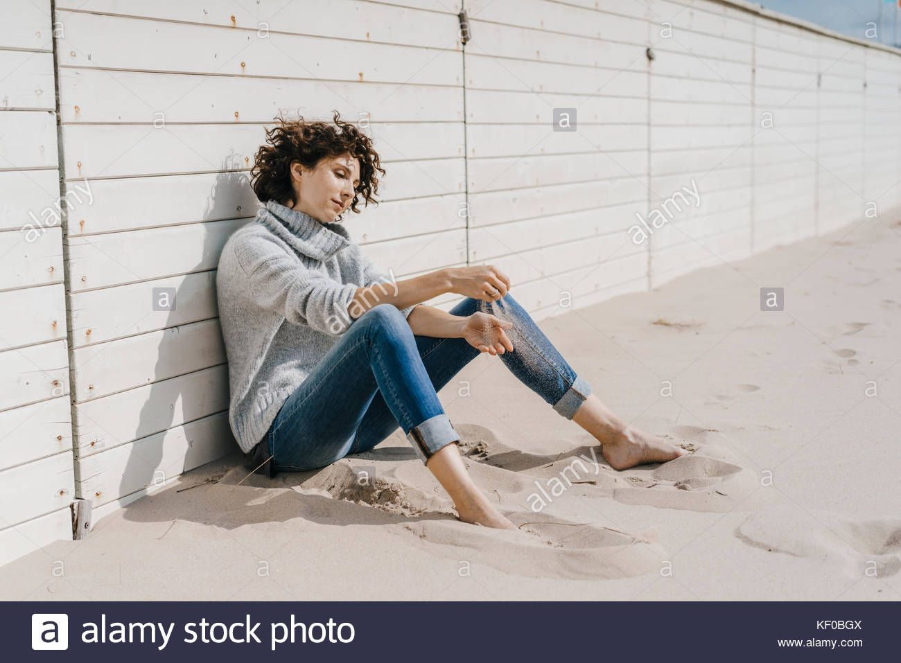 Woman Sitting On The Beach Leaning Against Wooden Wall Stock Photo 164122250 Alamy Stock Photos Woman Photo Stock Photos