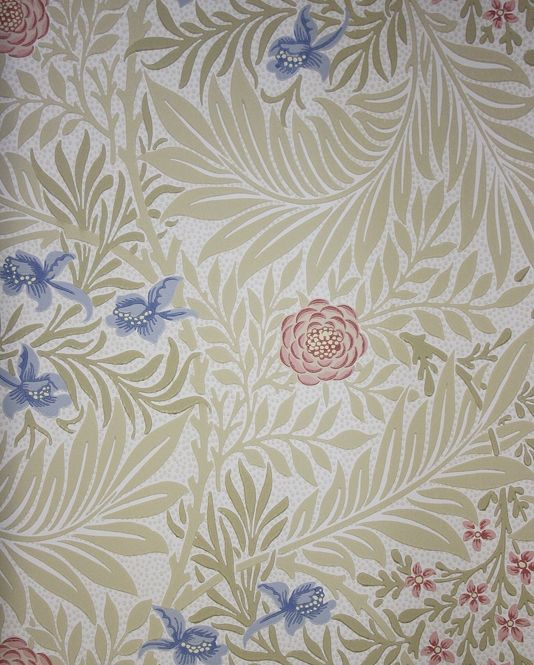 Larkspur Wallpaper A sweeping floral wallpaper featuring pretty light blue and pink flowers with manilla foliage on a cream background.