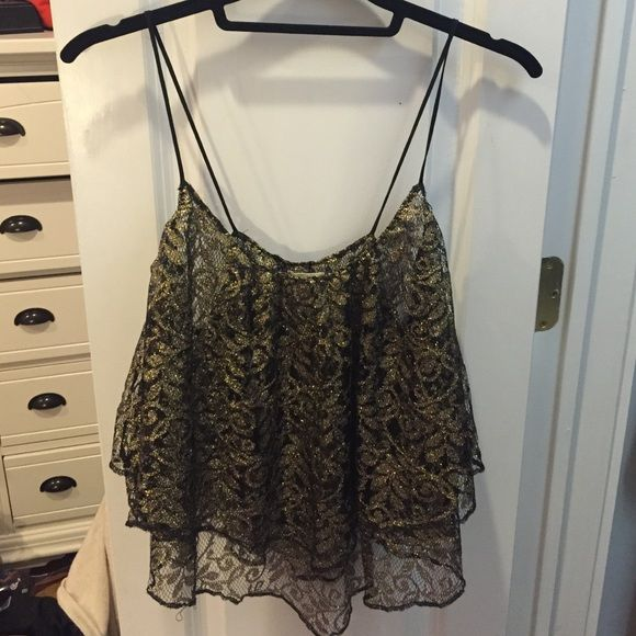 Urban Outfitters ecoté Lace Top Urban Outfitters ecoté Lace Top. Size Medium, black and gold. Perfect going out top! Second picture shows sheer-ness but easily can be worn with a black bandeau or strapless bra. ✨Make me an offer!✨ Urban Outfitters Tops