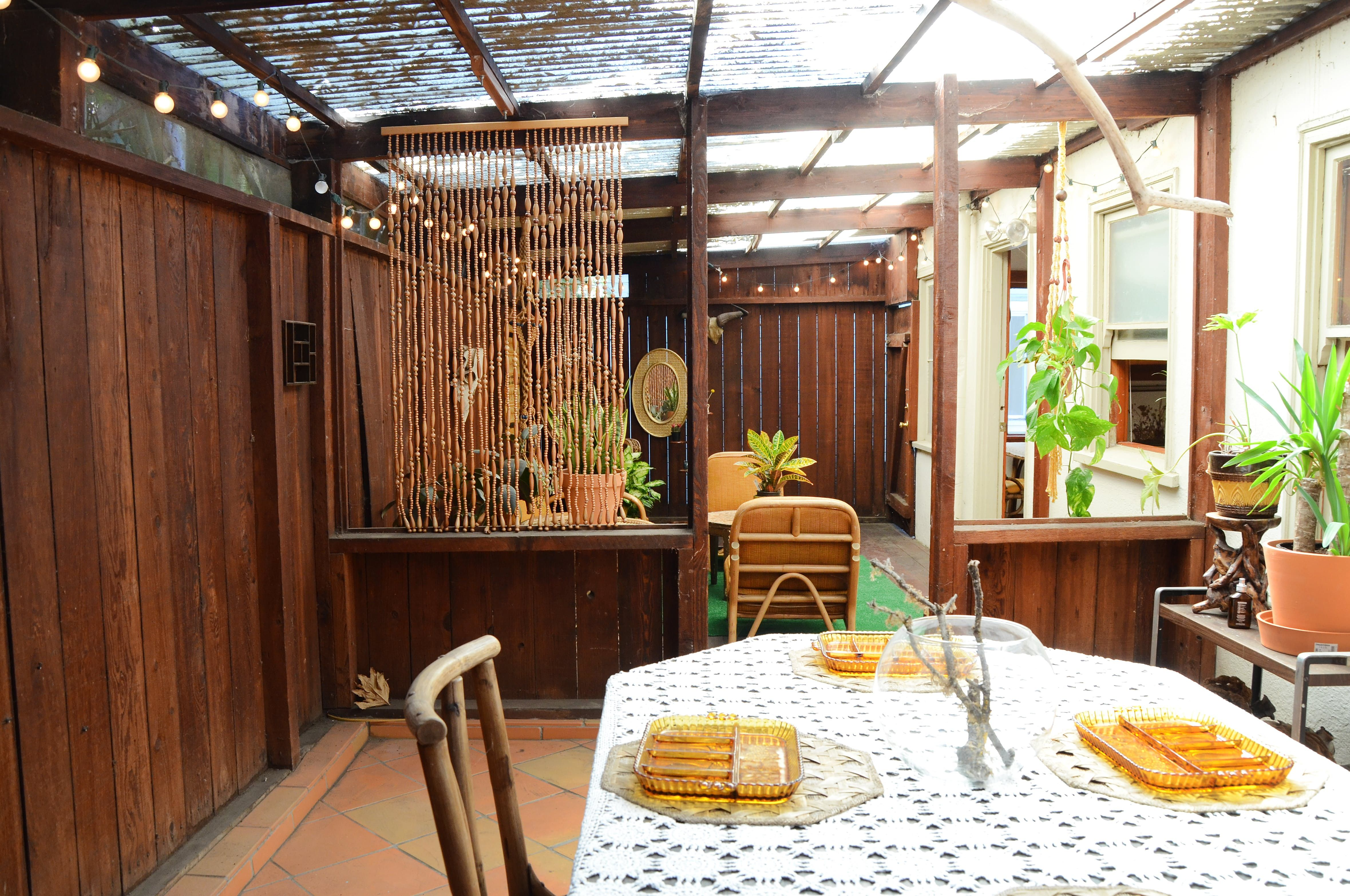 """Jen loves her Oakland home for it's natural elements, moody lighting, and most of all, the dreamy back patio. """"I can't think of any other place I'd rather live."""""""