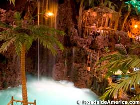 Casa Bonita in Denver. They put on a cliff diving show while you eat.