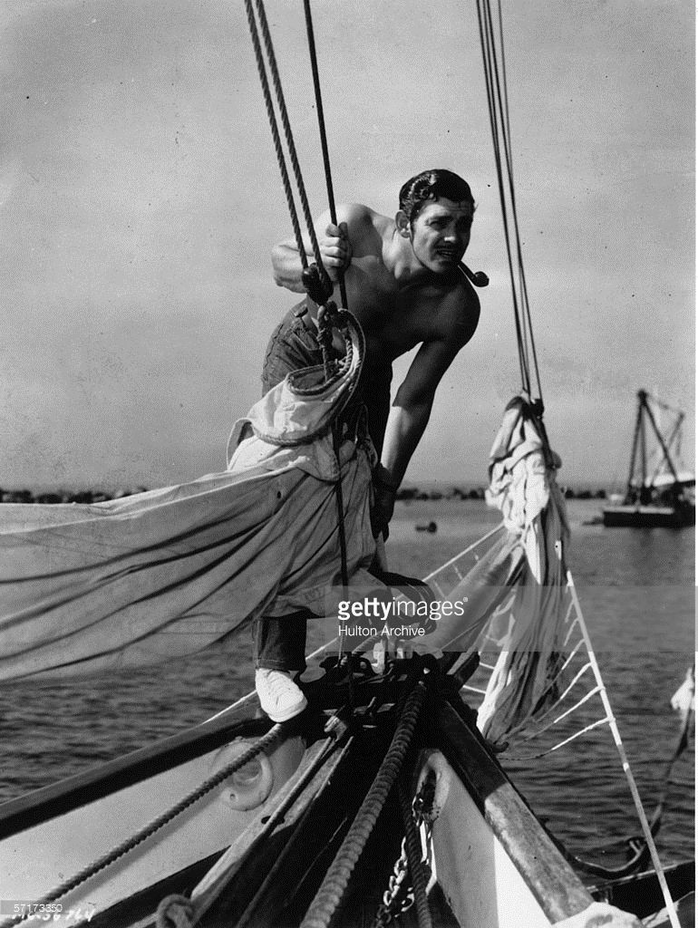 American screen star Clark Gable (1901 - 1960) enjoys a day out on actor Allan Jones' schooner, the 'Alrene', circa 1936. Jones was married to actress Irene Hervey, hence the name of the boat.