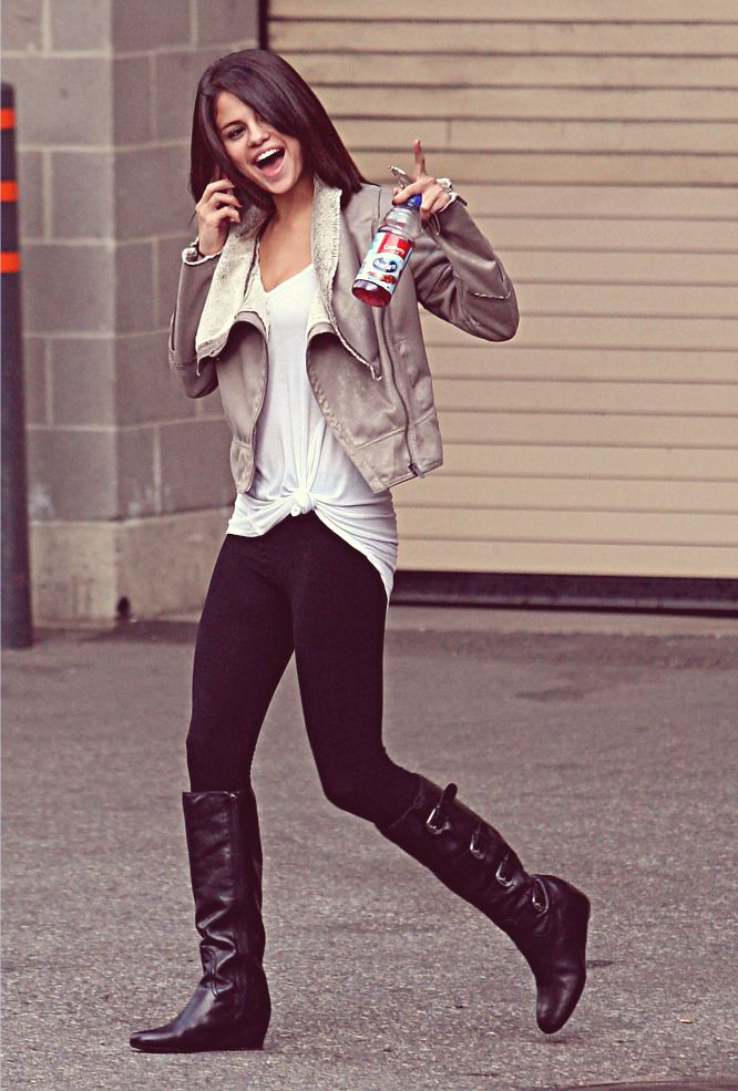 Selena Gomez | Causal outfit | Black leggings | white shirt |light grey leather jacket | black ...