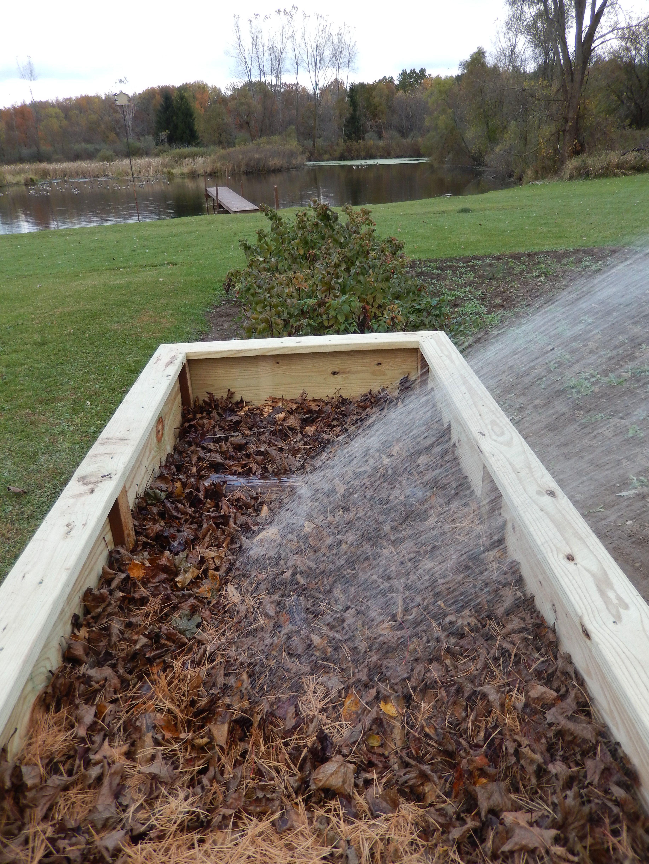 Step 3 of Hugelkulture raised bed... covered rotting wood