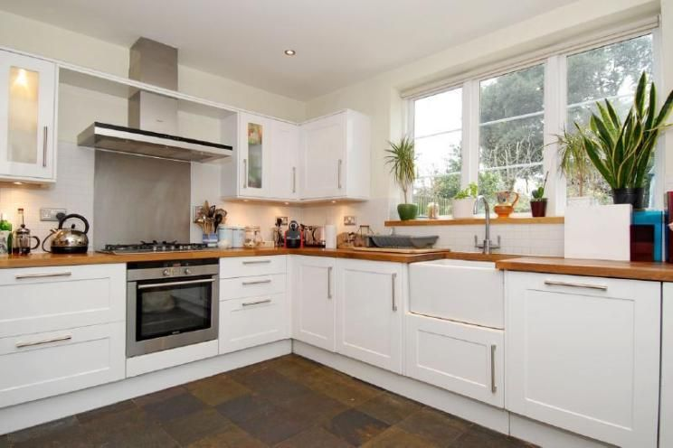 photo of classic modern white kitchen with belfast sink stainless ...
