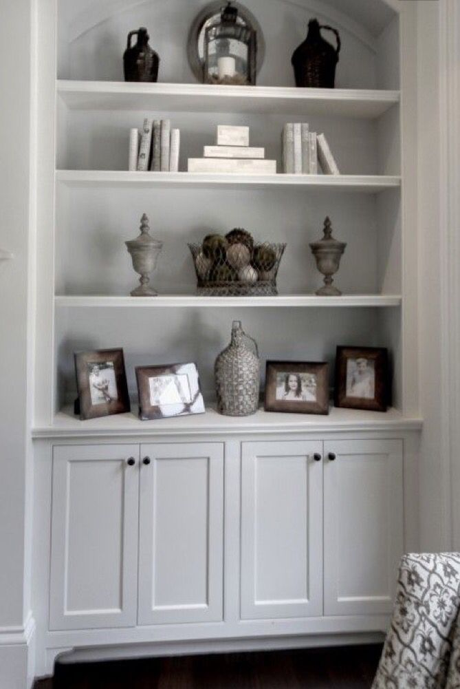 Shelves over cabinet next to fireplace our fire pit - How to decorate shelves in living room ...