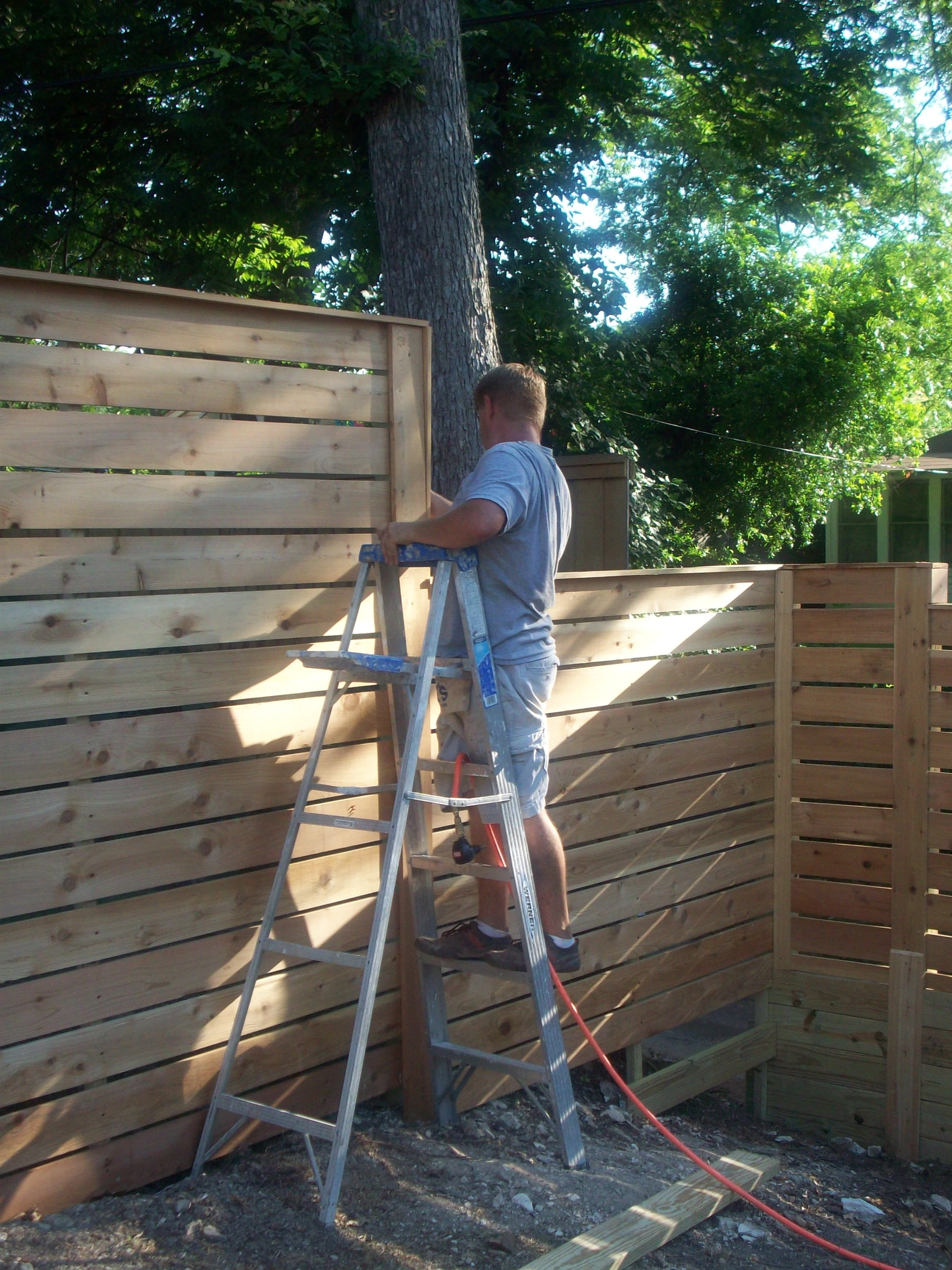 Jack putting some finishing touches on the fence diy pinterest
