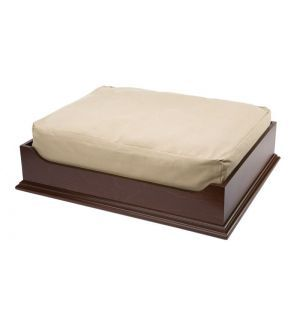 The Norman Wood Pet Bed is handcrafted and American-made with quality birch wood and finished with a classic walnut stain. The cushion is made of flame-retardant foam with a removable pre-shrunk cotton blend cover for easy cleaning. Cushion cover is machine washable. Dimensions: 24 in. x 19.5 in. x 5 in.