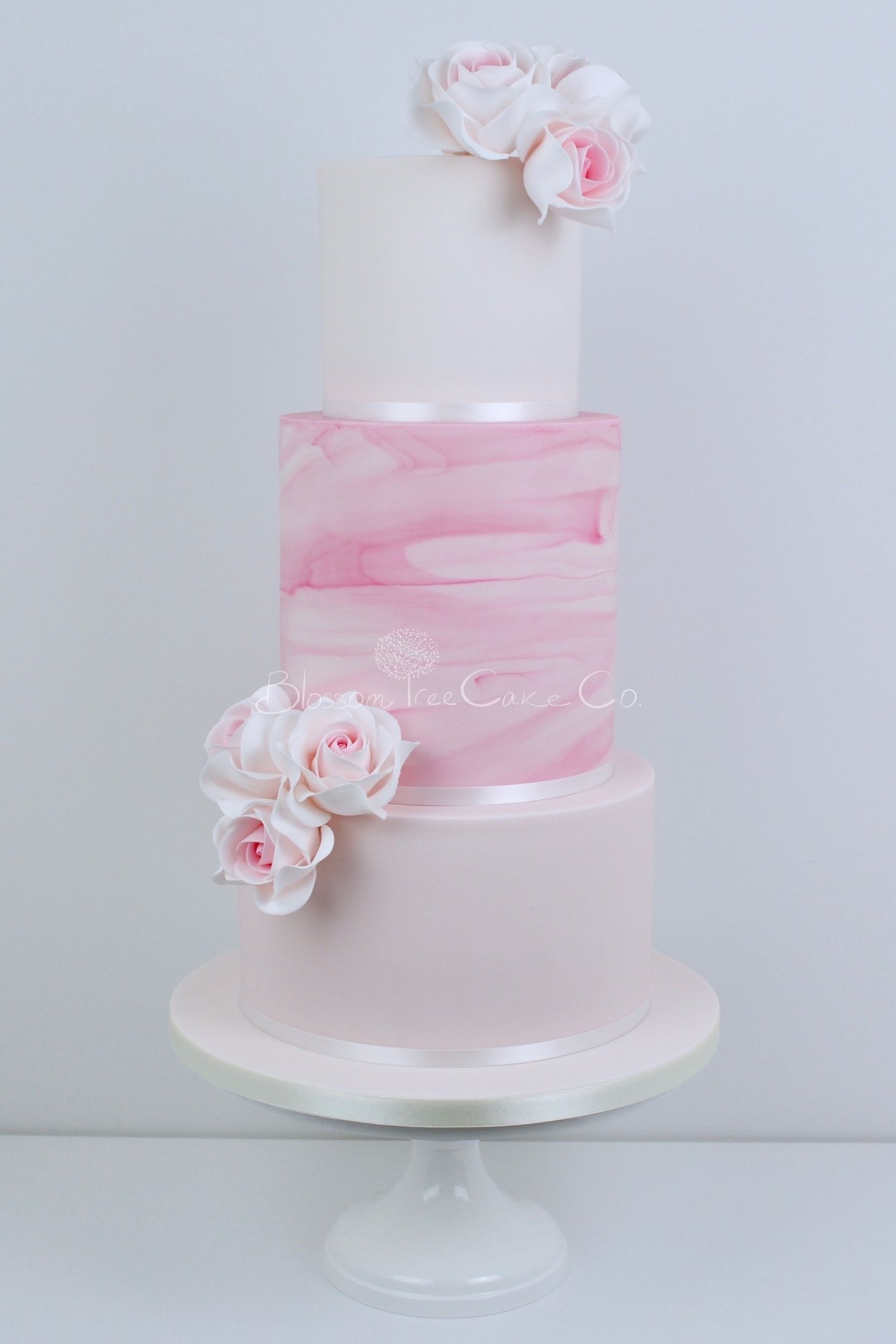 Beautiful Swirls Of Pink Marble Icing And Delicate Roses For A Romantic Dream Wedding Cake