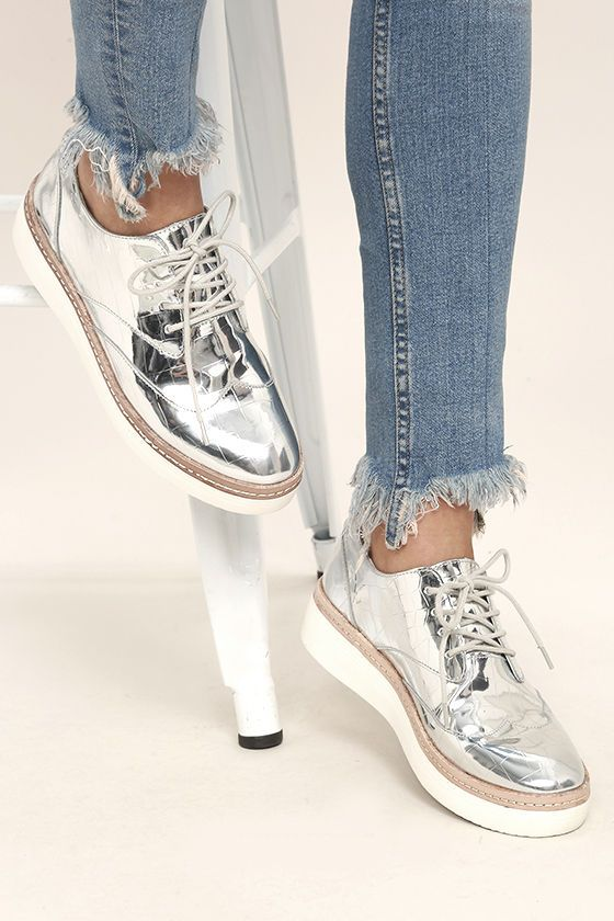 0e53dd0d8ece We are bowing down to the beauty that is the Steven by Steve Madden Pharo  Silver Patent Platform Sneakers! Crocodile-embossed metallic silver faux  leather ...