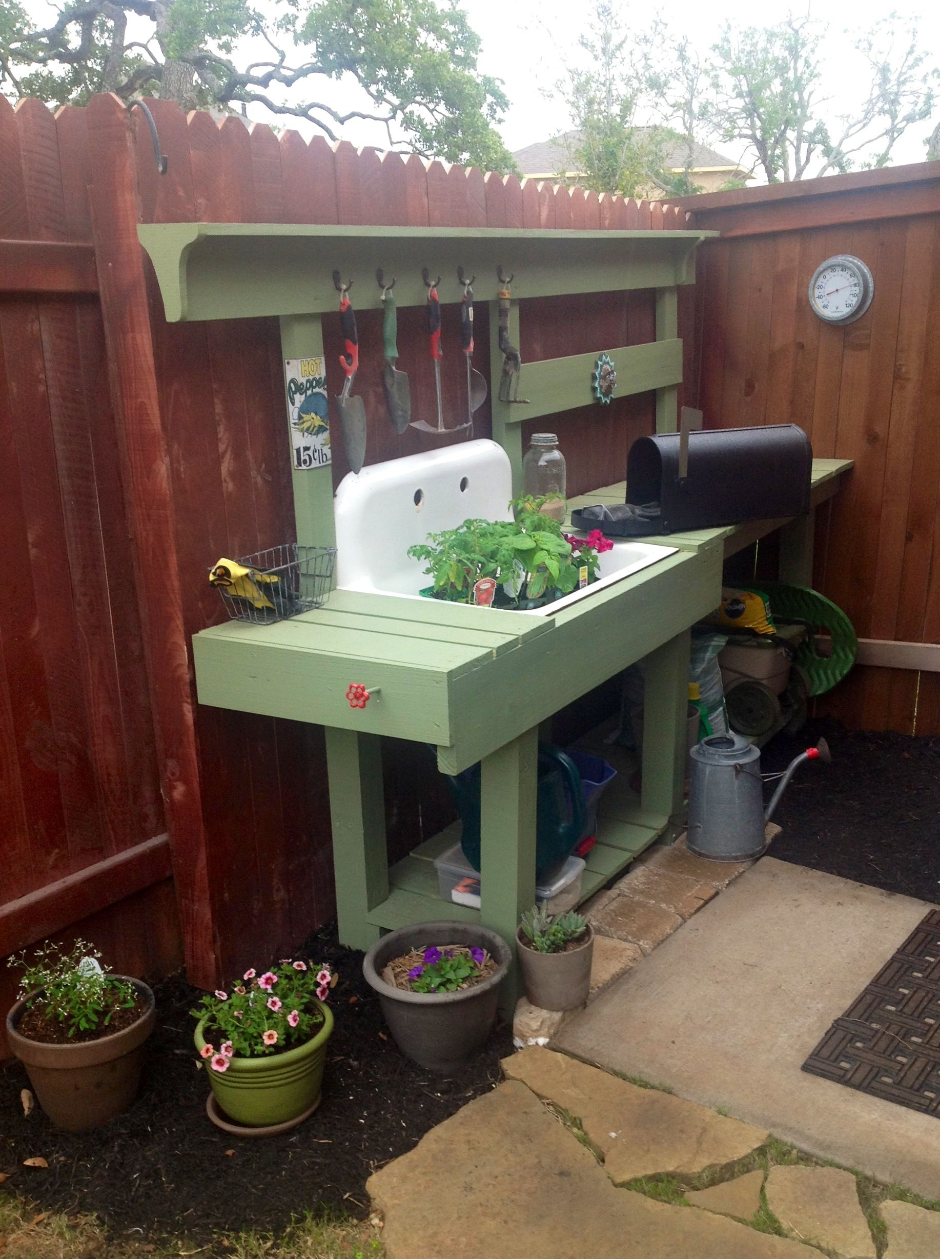 My new potting bench using an old sink & pressure treated lumber. Lots of room to store soil, fertilizers and tools while providing a sturdy workspace. Love....