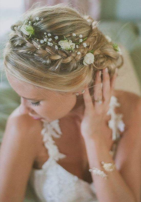Romantic wedding hair ideas http://www.weddingchicks.com/floral-bridal-hair-ideas/