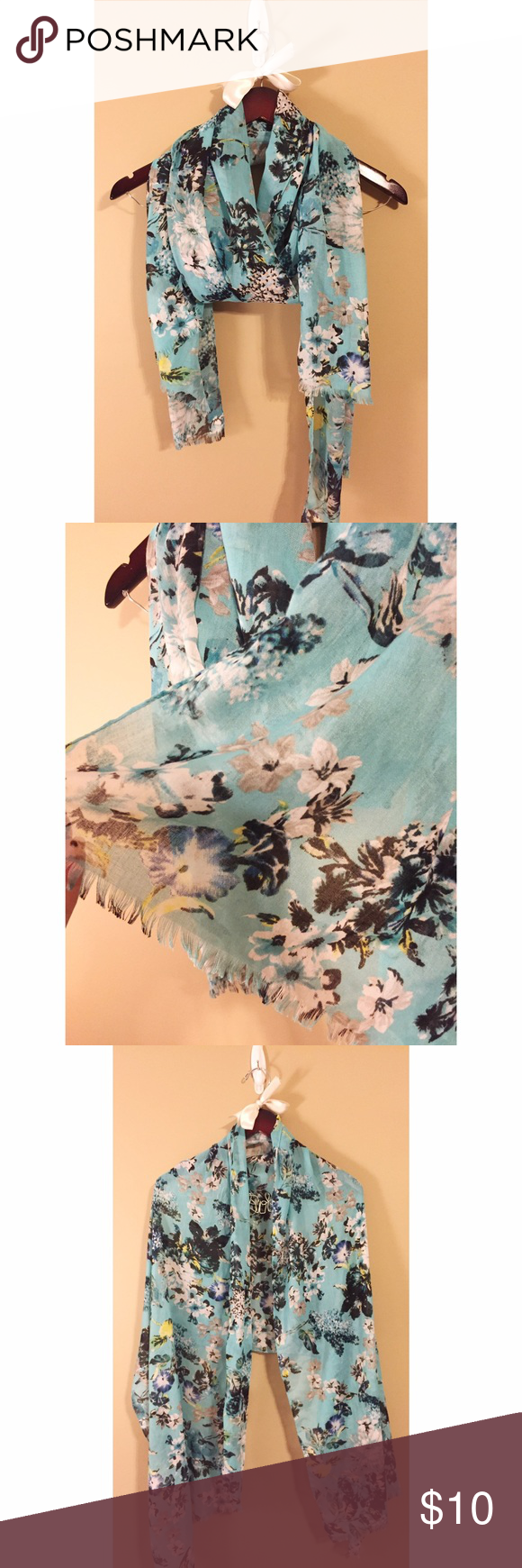 🆕Turquoise floral scarf/wrap Turquoise floral light weight scarf. Material is like a soft, linen material. Fringe on the ends, manufactured that way. Only wore once. Selling to downsize my scarf collection. Can be worn as a wrap too! Merona Accessories Scarves & Wraps
