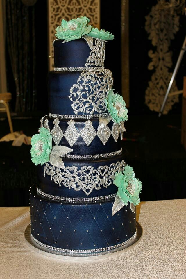Navy Blue And Silver Wedding Cake With Green Pheonies Blue And