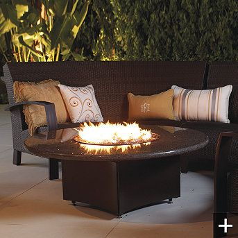 Oriflame Fire Table by Frontgate.  Okay...being that I live at the beach this is just practical.  A true merge of form and function, this Fire Table generates up to 60,000 BTUS of heat.  Sea breeze and fog proof!