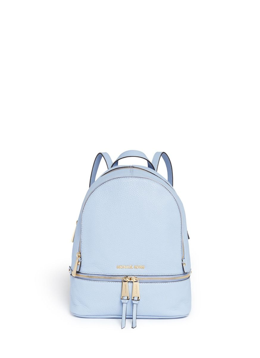 Love my Pastel Blue Michael Kors backpack. This is my everyday bag.