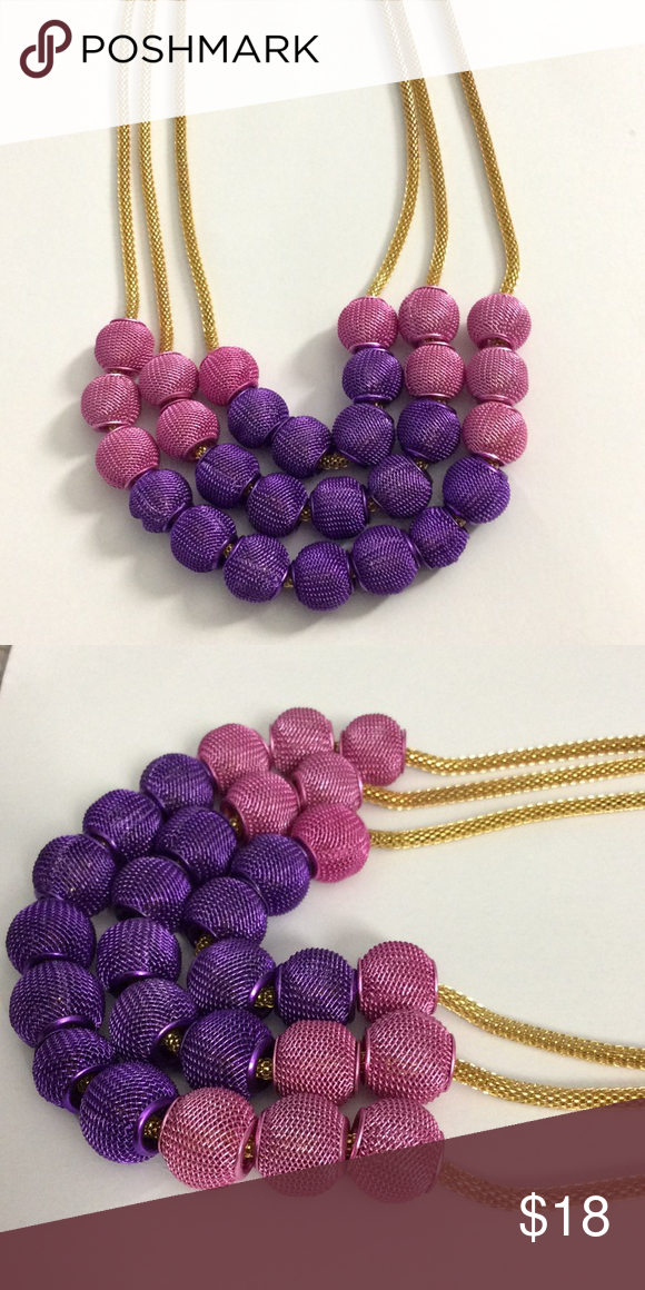 Pink purple gold statement necklace new Floating balls in pink and purple colors. 18 inches long with lobster clasp and extender. Exclusive Jewelry Necklaces