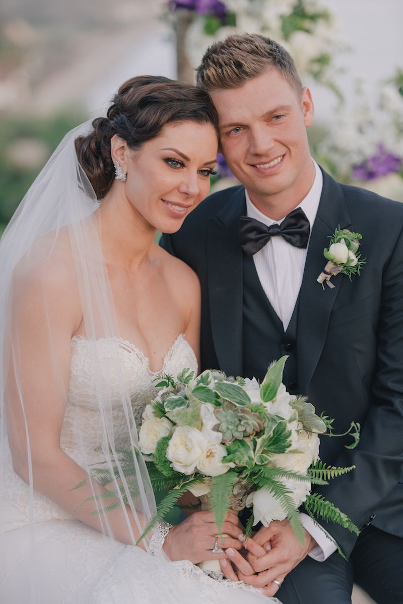 Backstreet Boys' Nick Carter & Lauren Kitt Smile at Ceremony | Photography: Kris Kan. Read More: https://www.insideweddings.com/weddings/lauren-kitt-and-nick-carter/605/