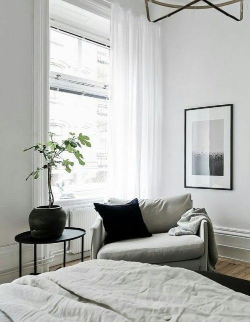 Photo of grey white bedroom