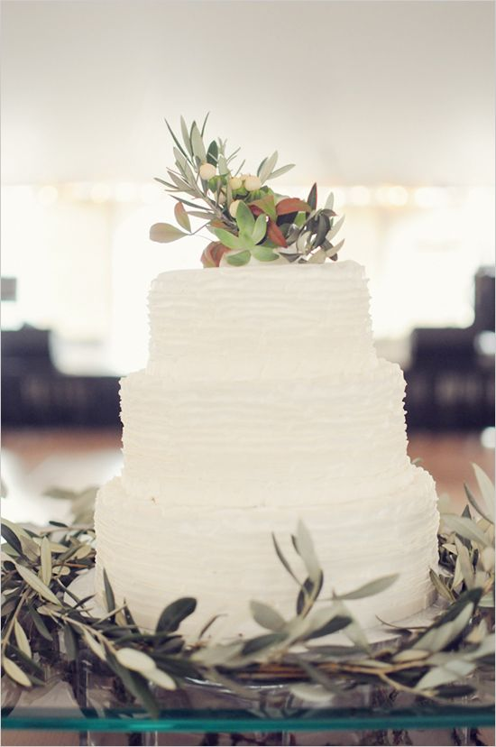 white wedding cake with olive branches