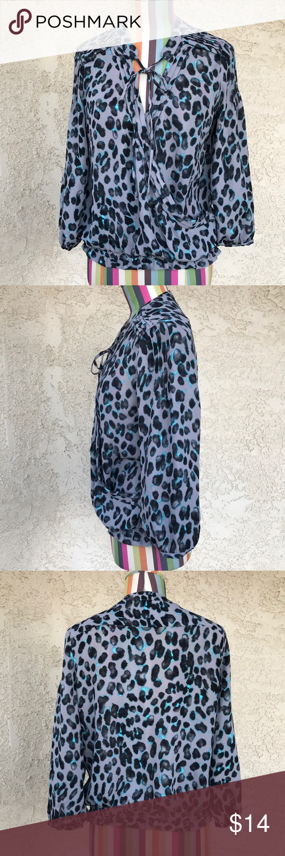 """New York & Company Blouse 100% polyester   Gray and blue leopard print blouse with folds details and elastic bottom. Great condition.  Length: 22"""" Pit to pit: 18.5"""" New York & Company Tops Blouses"""