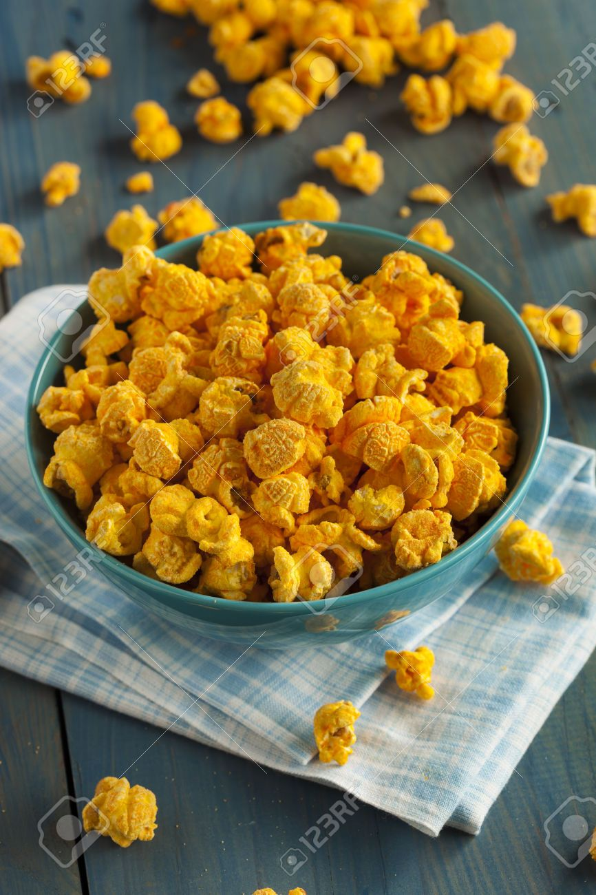 Homemade cheddar cheese popcorn in a bowl cheese popcorn