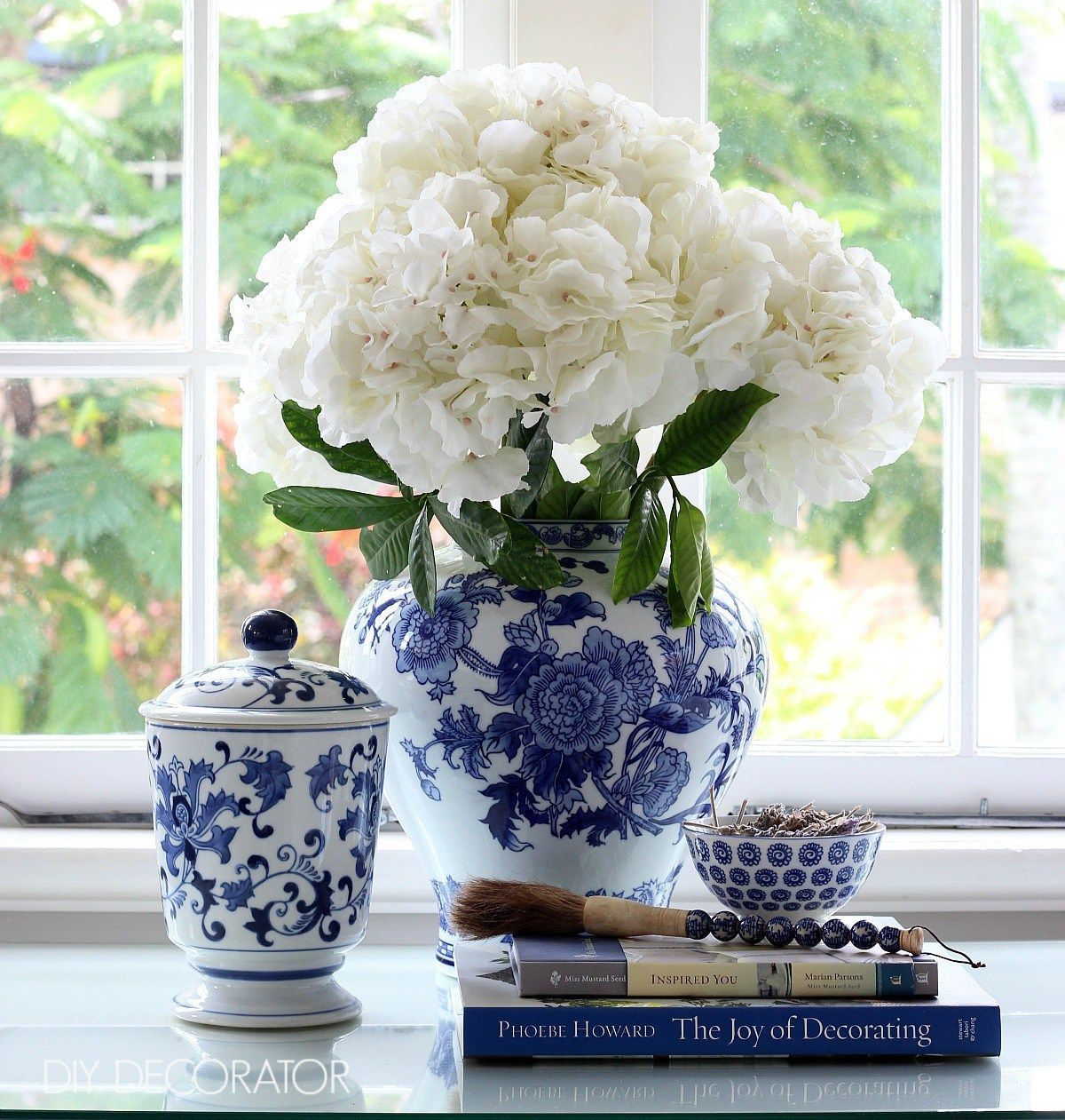 Book Toppers to Try at Home - easy ideas to create a pretty book vignette. Click to see them all. Blue and white